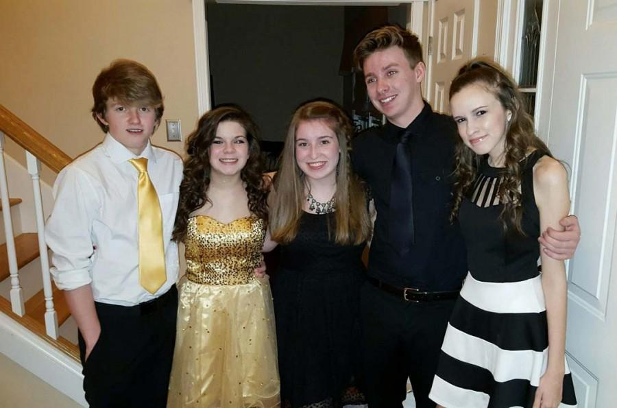 """(left to right)  Zac Neal, Daryen Hilt, Brooke Waters, Nick Goudie and Marissa King together after preparing to go to Sadie Hawkins. """"It was really cool... we partied and danced to the songs."""" Waters said. The group ended up having a lot of fun together."""