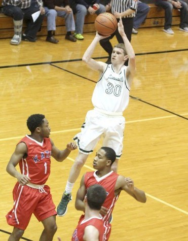 Zionsville Boys Basketball Dominates in First Round of Sectionals