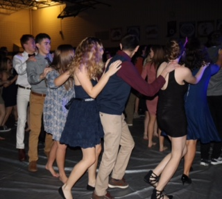 Some students form a conga line at Sadie Hawkins.