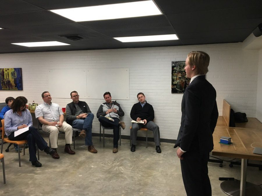 Senior Jared Thies pitches a business plan to local entrepreneurs.