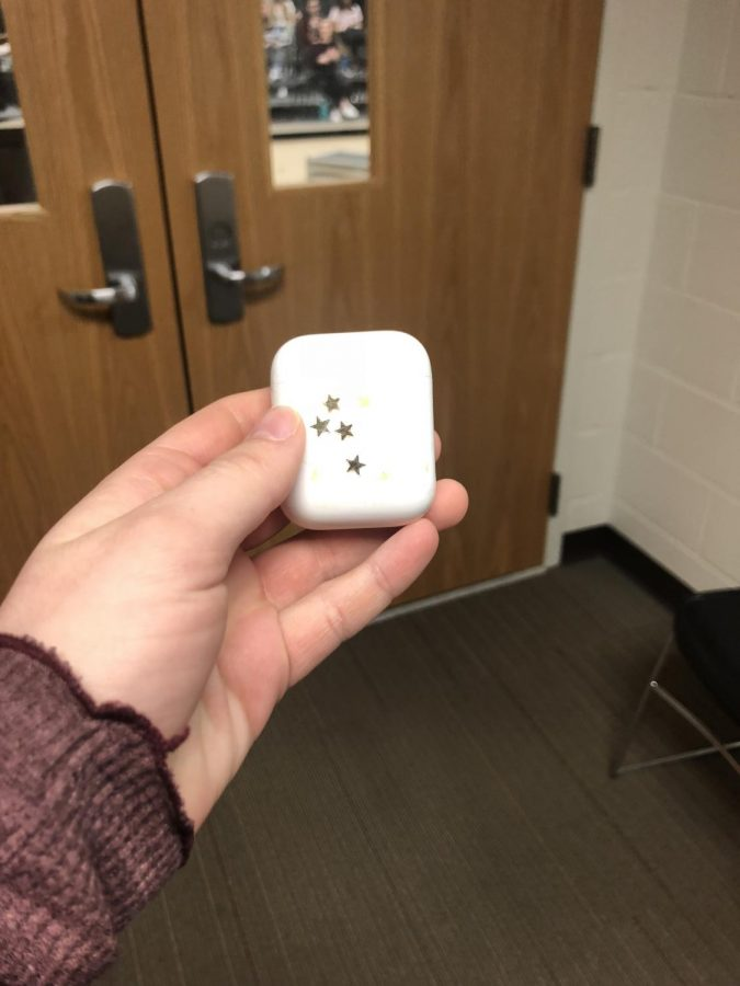 Charlatte+Kauffman%2C+junior%2C+shows+off+her+AirPods+case+while+in+study+hall.+