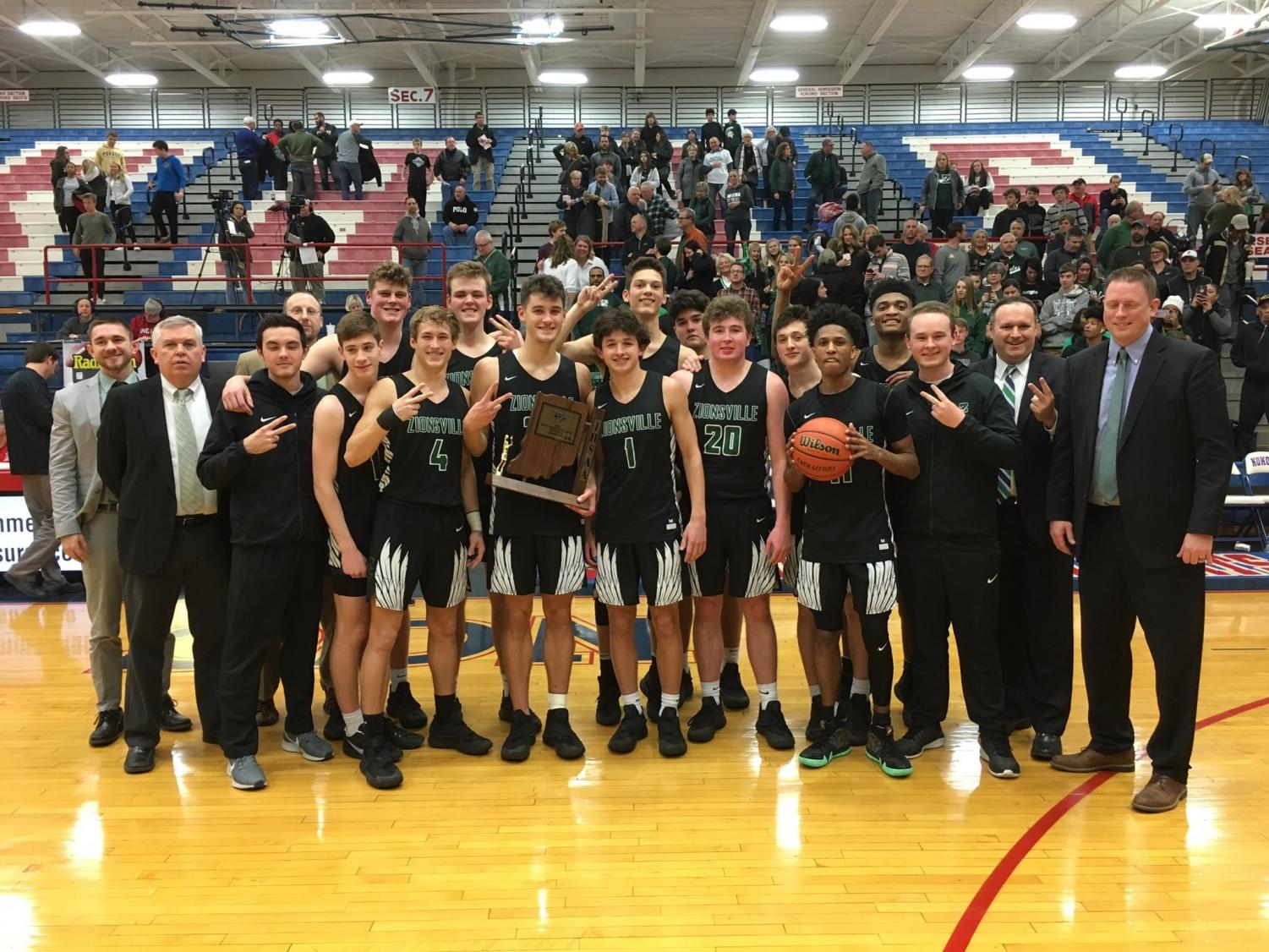 Photo provided by the Zionsville Boys Basketball twitter. The team celebrates their win Saturday night with the Sectional Seven trophy.